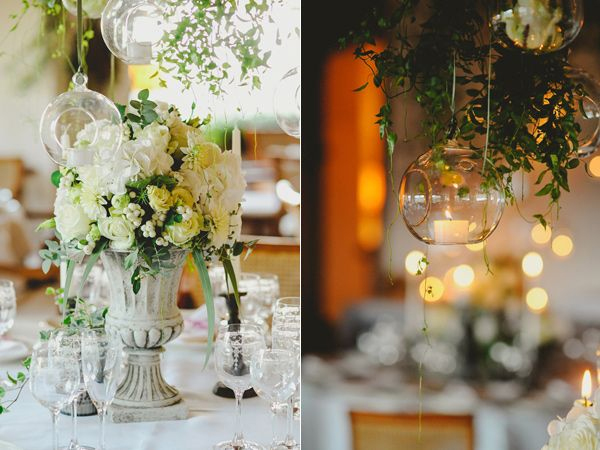 tuscan wedding centrepieces grey urns with hanging glass vases