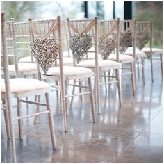 wicker hearts tied to chairs make fab non floral aisle decorations and can be used elsewhere at the wedding