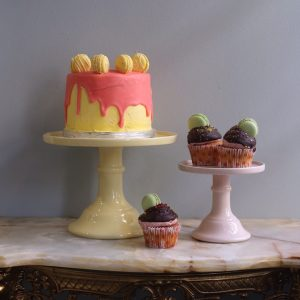yellow and pastel pink cake plates for wedding cakes