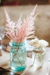 blue and blush pink wedding idea pink astilbe in blue mason jar
