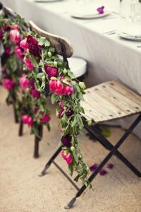 chair back ideas for summer weddings - relaxed rustic flower garland