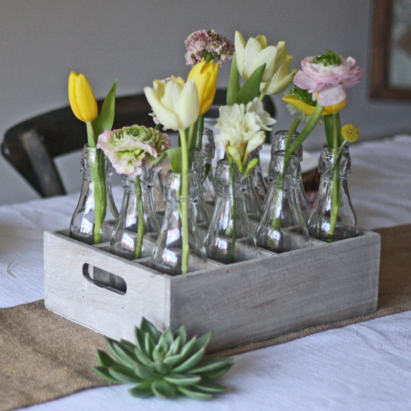 country style wedding centrepiece 12 wooden bottles in woode crate