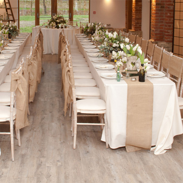 hessian table runners for woodland weddings - these look good on long tables and round tables