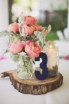 navy blue and blush pink wedding centrepiece on wooden tree slice