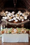 white paper lanterns above dessrt table available from www.theweddingofmydreams.co.uk