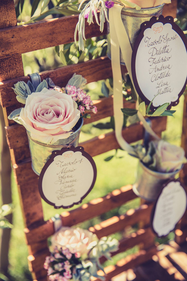rustic wooden table plan with flower pots available from The Wedding of my Dreams