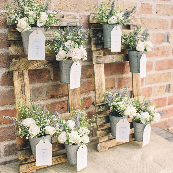 woodland wedding table plan made from wooden frames and flower pots