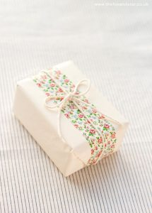 use washi tape to finish of bridesmaid gift wrapping