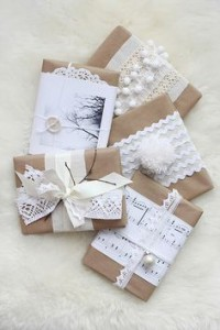 cute ways to wrap bridesmaid gifts brown paper lace sheet music beads and buttons
