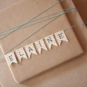 brown paper and paper bunting write recipients name on the bunting