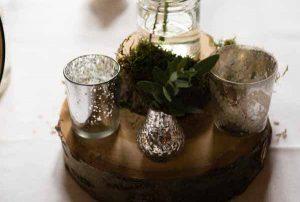 woodland wedding centrepiece tree slice mercury silver vases candle holders