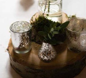 woodland wedding centrepiece tree slice mercury silver vases candle holders