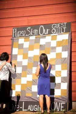 ask guests to sign a quilt or picnic blanet - wedding guest book ideas
