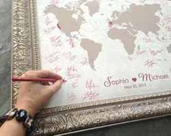 ask guests to sign a world map - wedding guest book ideas for travle wedding theme