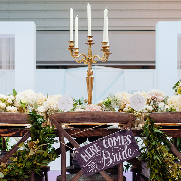 gold candelabra wedding centrepiece