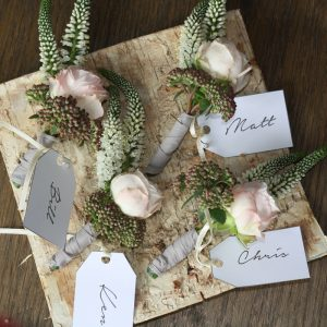 rustic button holes presented on birch bark