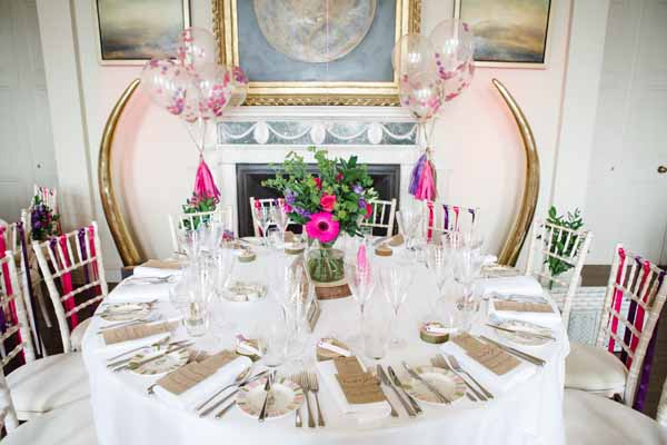 Tree slice Centrepieces with Giant Balloons Real Wedding at Aynhoe Park Bright Pink Fun Wedding Decorations (1)