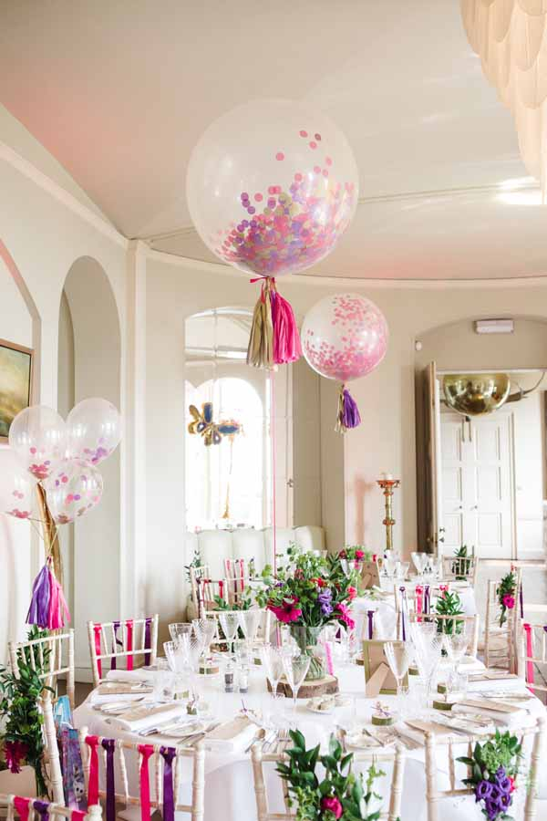 Tree slice Centrepieces with Giant Balloons Real Wedding at Aynhoe Park Bright Pink Fun Wedding Decorations (2)