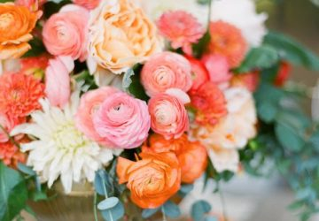 coral wedding centrepieces in gold vases