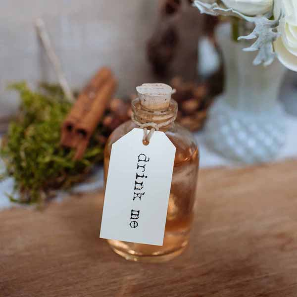 mini glass bottles with corks  - featured in the top 10 wedding favour bags and boxes