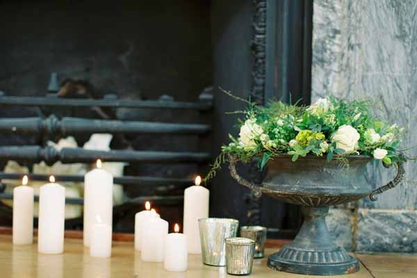 wedding fireplace ideas with candles urns candle sticks and foliage (2)