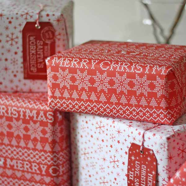 Christmas_wrapping_paper_red_and_white_merry_christmas_snowflakes
