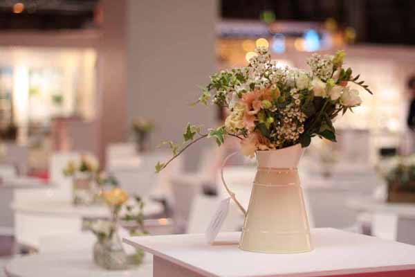 Cream jug wedding centrepieces