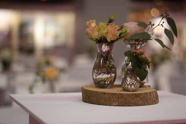 Mercury silver vases grouping wedding centrepieces on tree slabs