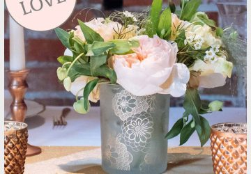 gold vase wedding centrepiece with floral pattern