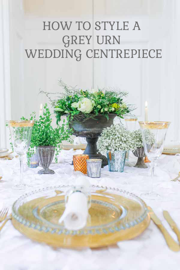how to style a grey urn wedding centrepiece white and green florals