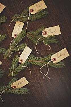 winter wedding place cards luggage tags tied to fir tree