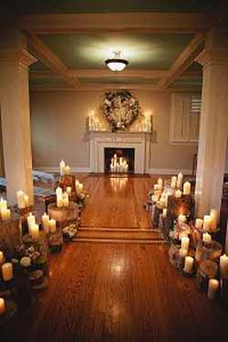 woodland ceremony ideas tree stumps and candles down aisle