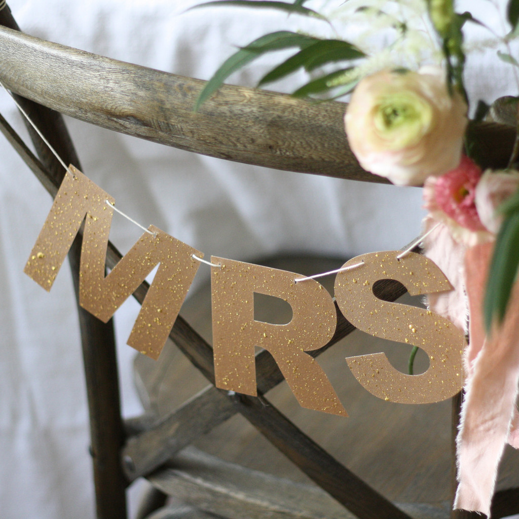Bronze glitter chair signs by @theweddingomd - metallic wedding ideas