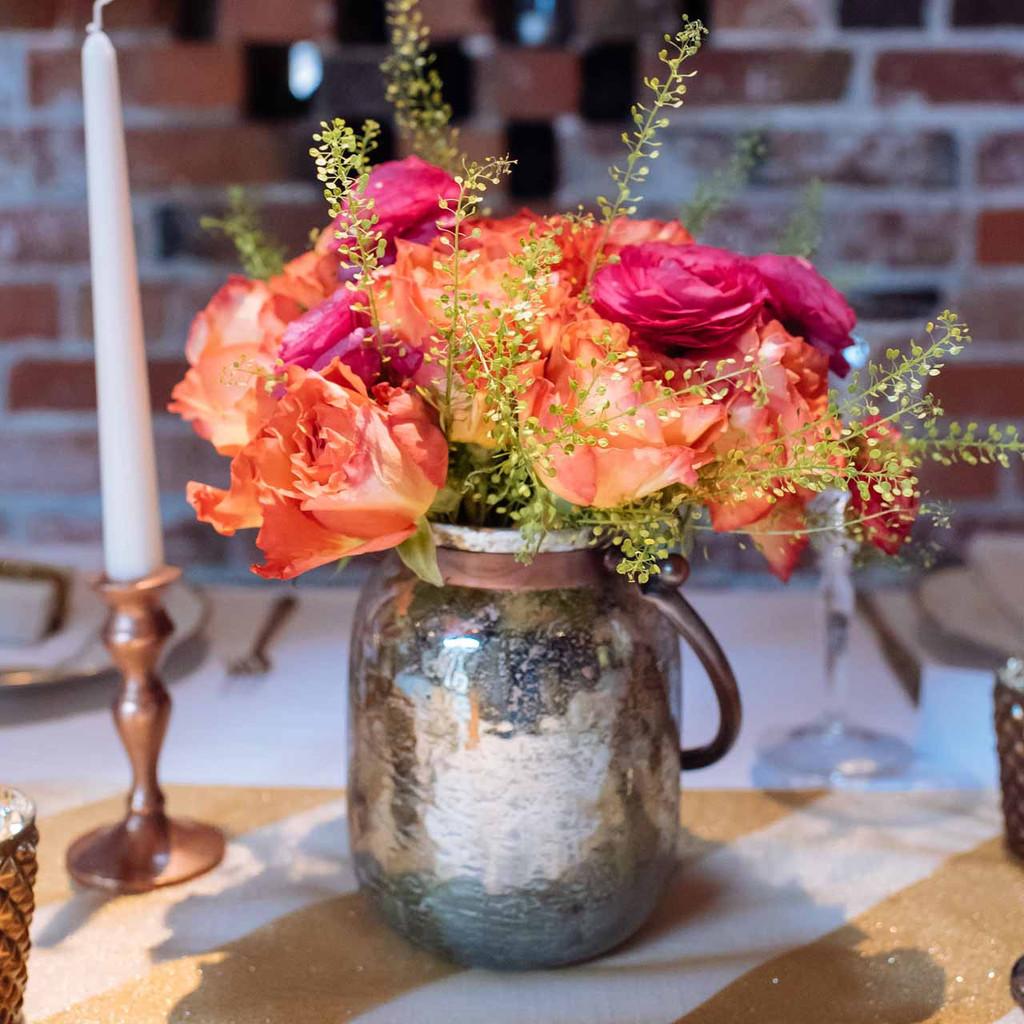 Metallic-bronze-vase-wedding-centrepieces-by-@theweddingomd-metallic-wedding-ideas