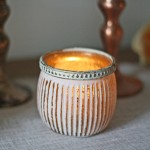 White and gold tea light holders by @theweddingomd - metallic wedding ideas