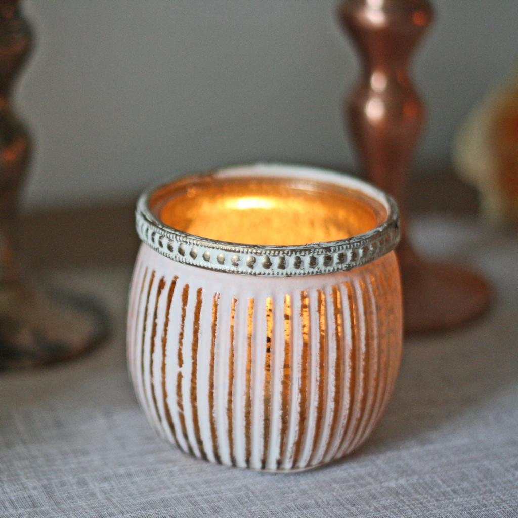White and gold tea light holders by @theweddingomd - metallic wedding ideas