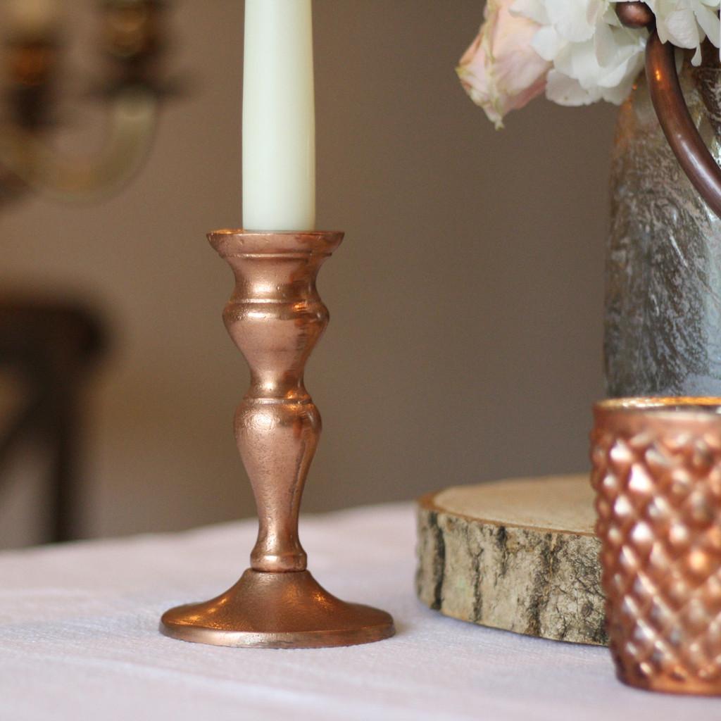 copper candlesticks by @theweddingomd - metallic wedding ideas