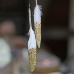 gold glitter feathers by @theweddingomd - metallic wedding ideas