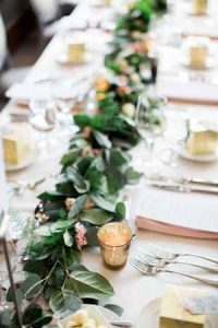 foliage-garland-running-along-table-with-gold-tea-light-hlders-to-add-a-touch-of-glamour-200x300