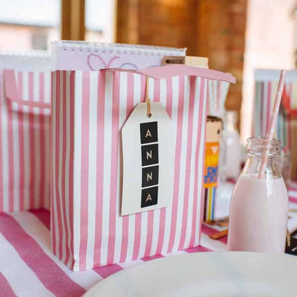 pink-and-white-striped-gift-bag-for-childrens-wedding-activity-packs-available-from-@theweddingomd