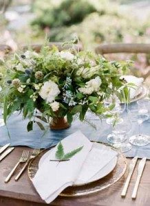 white-and-green-wedding-centrepiece-in-rustic-urn-218x300