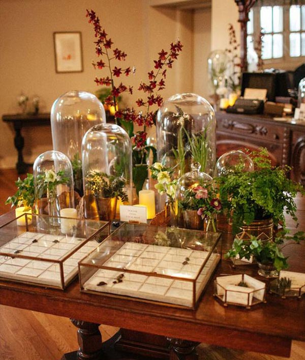 Love the idea of using bell jars of different heights at weddings on welcome tables or escort card tables