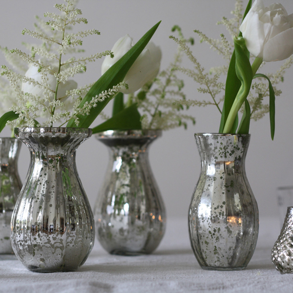 Small mercury silver vases available from @theweddingomd