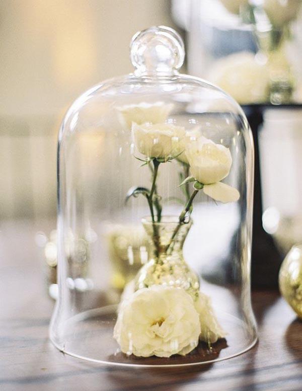 bell jars for wedding centrepieces, place a small bud vase withing the cloche