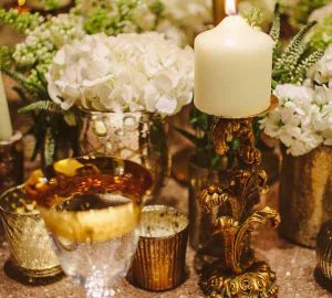 gold wedding table styling with tea lights and candle sticks square