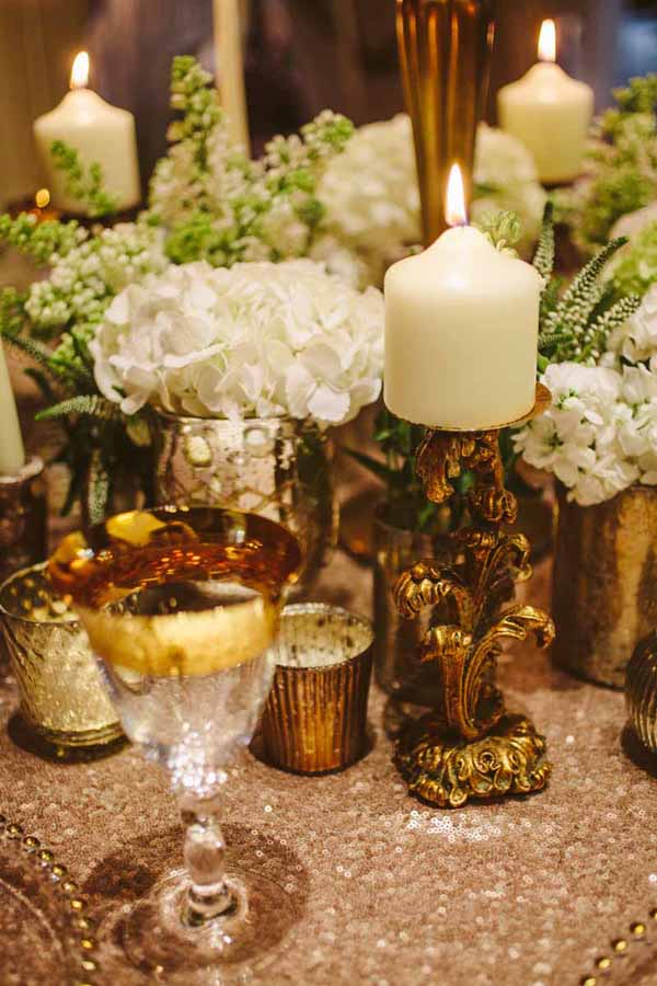 gold wedding table styling with tea lights and candle sticks