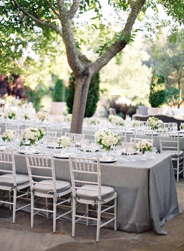 grey cotton table cloths look beautiful on outdoor wedding tables