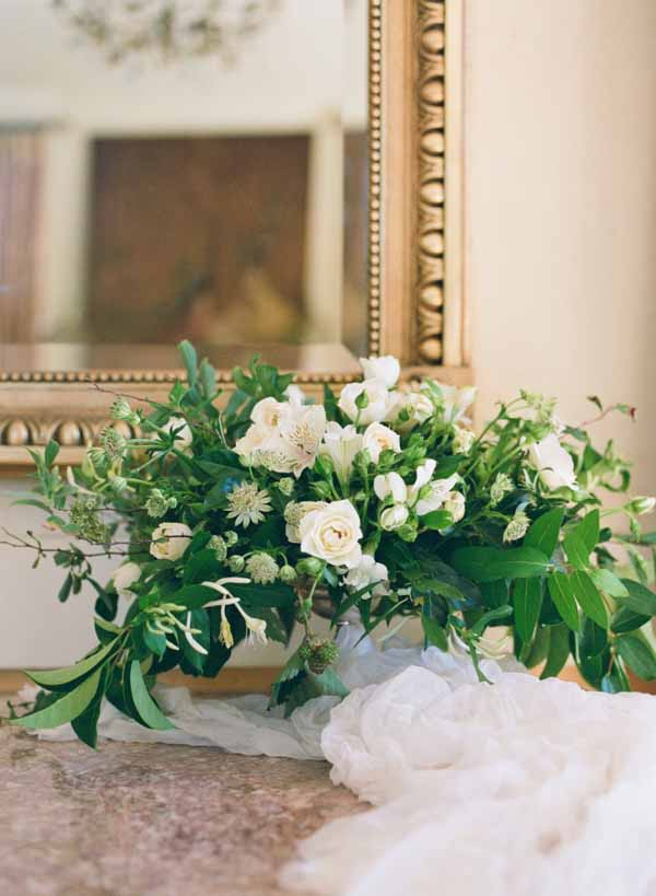 white cotton table runners on wedding entrance tables
