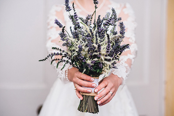 Pretty lavender bridal bouquet tied with hessian and lace wrap