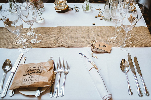 Rustic charm wedding usng hessian and lace detail Hessian table runner and burlap favour bags available from @theweddingomd as are the brilliant brown paper bags
